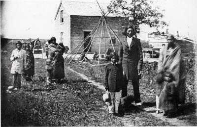 Robert Hopkins Chaska and family at Chaska's house near Dr. Thomas Williamson's Pajutazee mission near the Yellow Medicine Agency