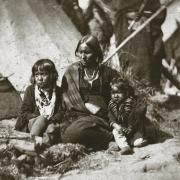 Little Crow's wife and children at Fort Snelling, ca. 1863.
